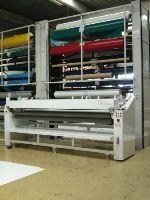 Machine de découpe pour matériaux enduits