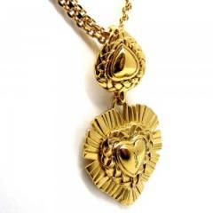 Pendentif en métal doré  Yves St Laurent
